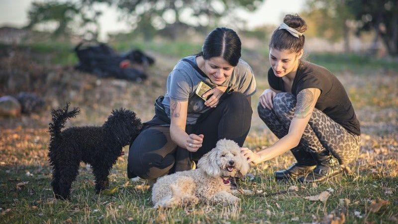 2 women petting dog