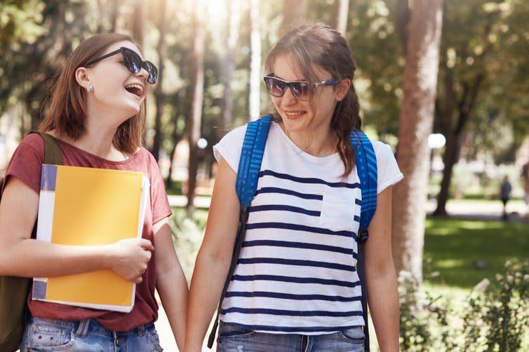 2 female studens on campus