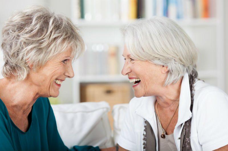 2 older women laughing