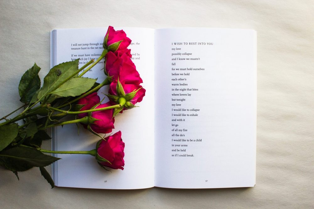 roses lying on poetry book