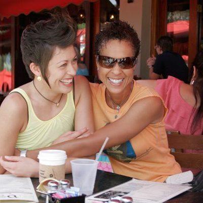 fort-lauderdale-2-women-hugging-on-table-lotl