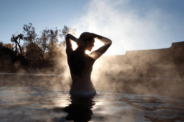 woman in hot spring in Taos