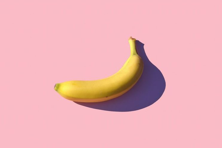 Banana with pink background