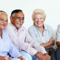 Group of seniors sitting and laughing