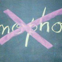 homophobia written on a blackboard