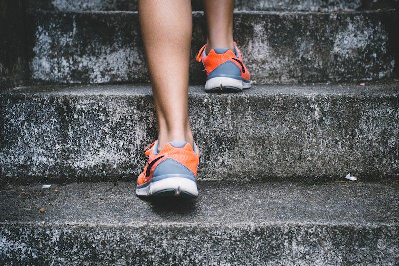 runners feet running up stairs